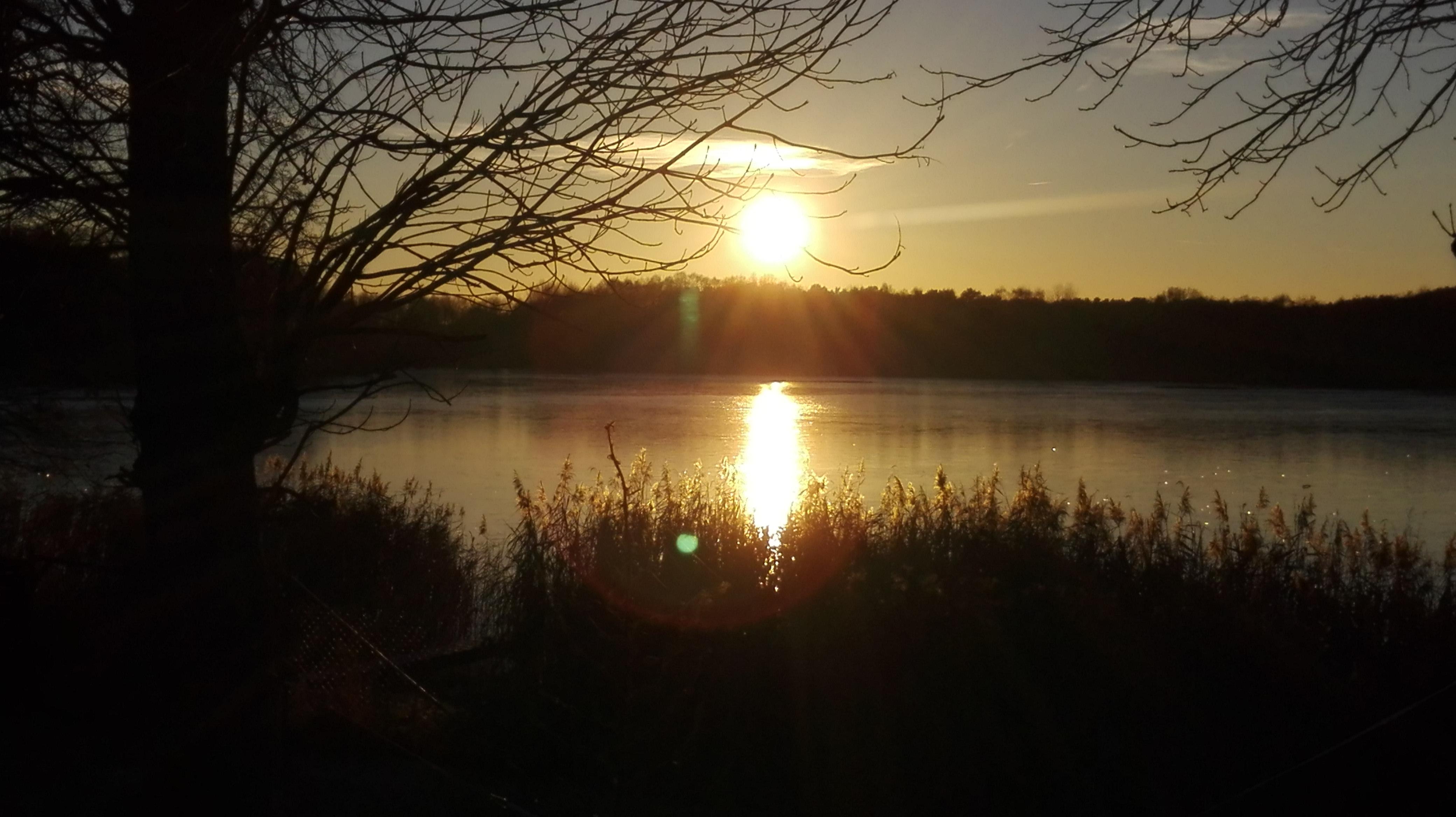 Sonnenuntergang winterhochzeit am see heiraten im winter